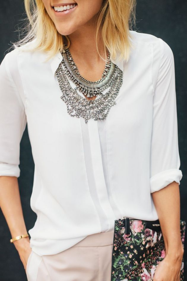 White blouse with statement necklace, click here to get more style tips from our expert stylists!