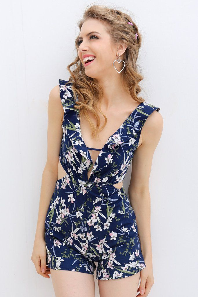 Ruffle Romper - Dark Blue  Navy Blue Perfection! Ruffles and Floral and Shorts! This romper is amazing not to mention the cutout sides and back will make them all beg for more!