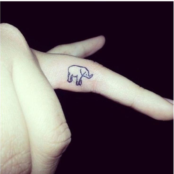 Little elephant finger tattoo