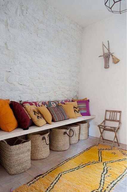 I love the built in bench with woven baskets underneath and pillows on top. Moroccan themed color pallet.