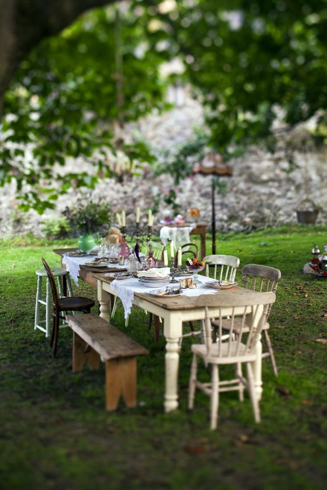 LOVE this stable setting ... rustic table top, simple lace, a bench and mismatched chairs