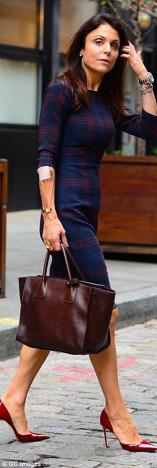 Bethenny Frankel in a fitted knee-length frock with a killer pair of red patent leather heels and a sleek brown leather tote