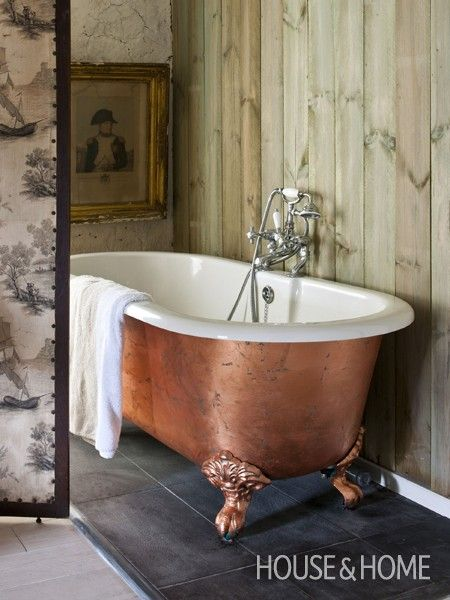 Get the look of a copper bathtub ..Annie Sloan covered the outside of her enamel roll-top bath in copper leaf.. To soften its appearance, she used Florence — a coppery green paint — underneath.
