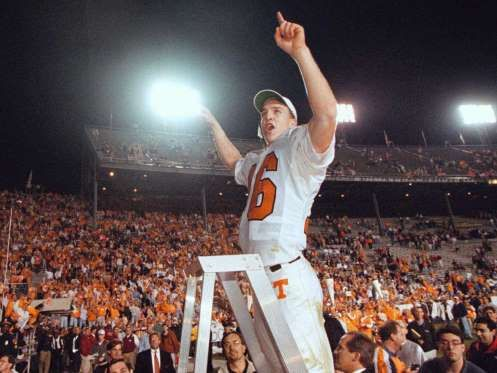"""Manning leads Tennessee fans in their fight song """"Rocky Top"""" after beating Alabama in 1997. - Scott Trigg, AP"""