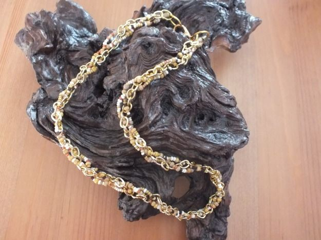 Necklace made with a plate between beads cord and golden chain. by PerfectLoveArts 19.00 €