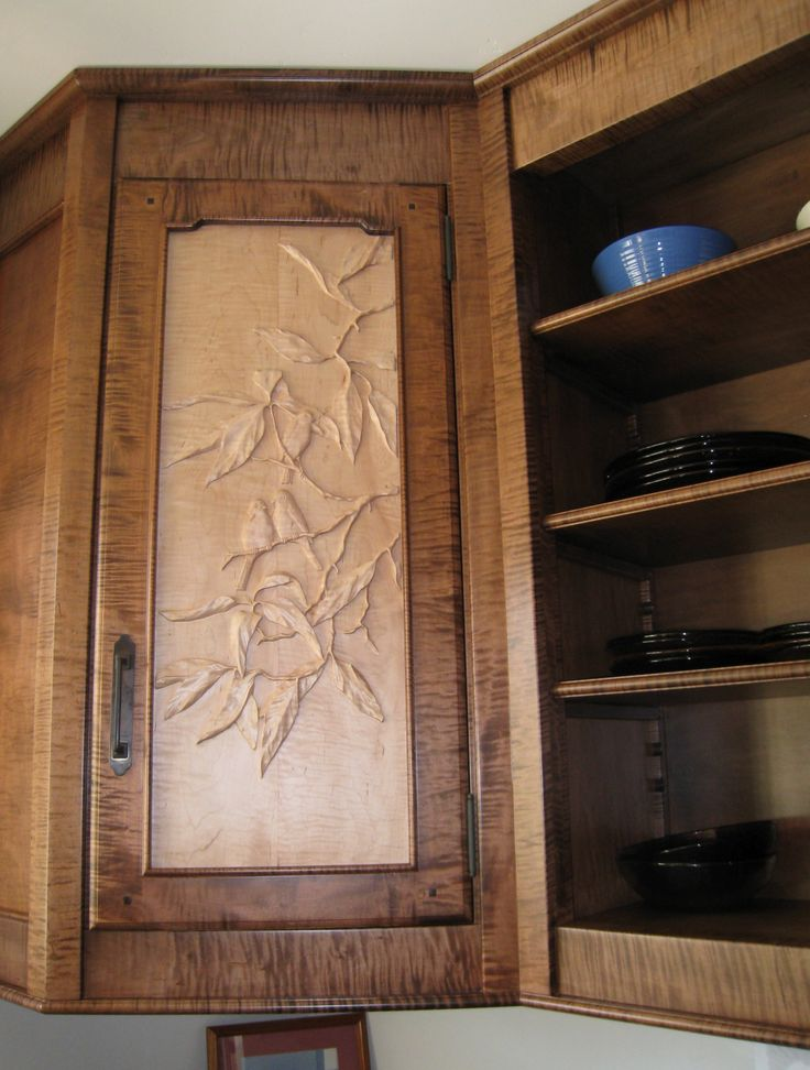 Close up of hand carved cabinet door panel birds in an for Avocado kitchen cabinets