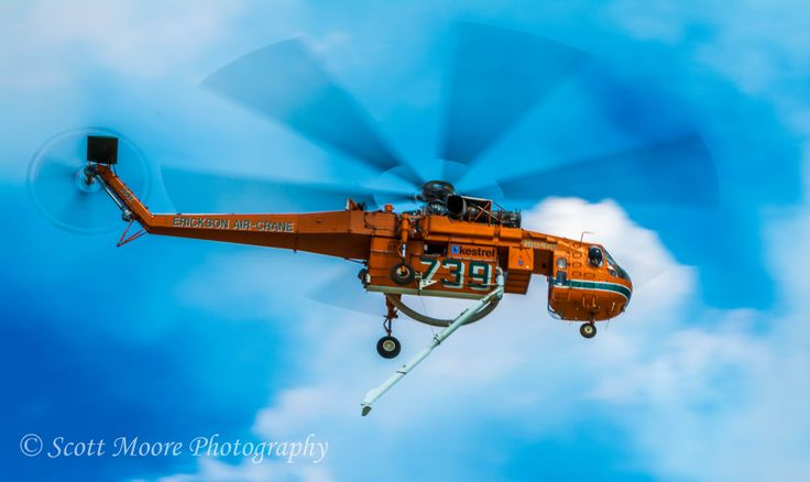 one of the helicopters working to save many homes from fire