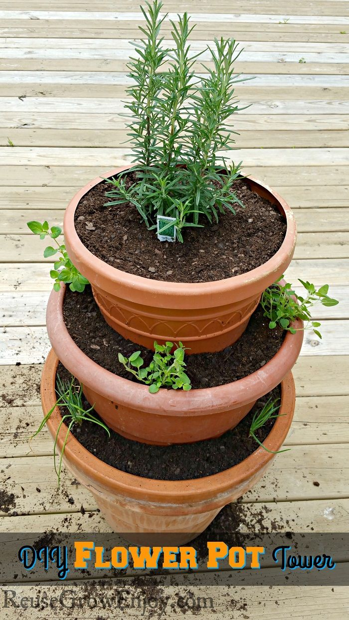 Need to grow some flowers or fresh herbs in a small space? Check out this DIY Flower Pot Tower! http://reusegrowenjoy.com/diy-flower-pot-tower/