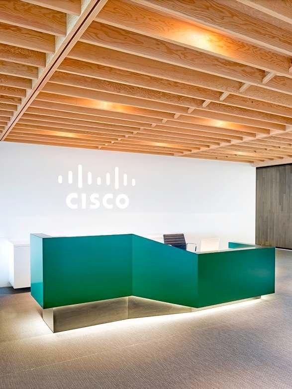 Reception desk contemportist cisco meraki office by for Total interior designs inc