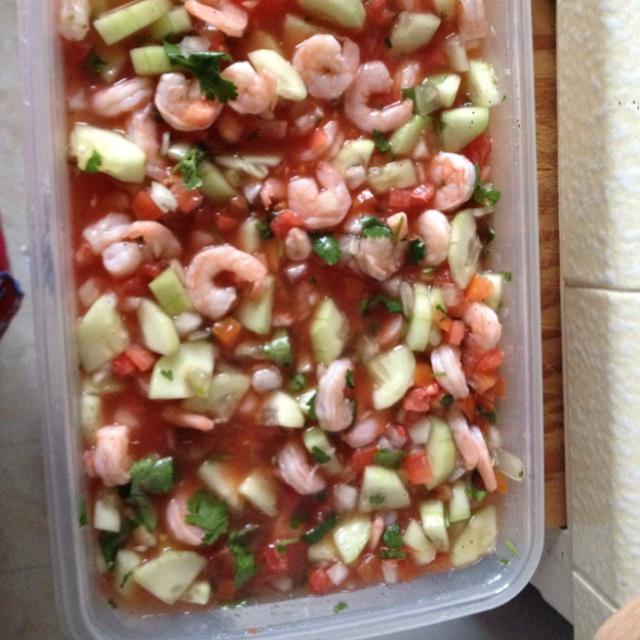 Fresh homemade ceviche. Ceviche Recipe: shrimp, clamato, lemon/lime, onion, tomato, cilantro, cucumber. Salt, pepper and cumin for taste.