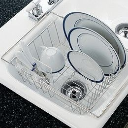 "Dry your dishes in the same place you wash them - the sink. Our Stainless Steel In-Sink Dish Drainer expands to fit over sinks up to 21"" wide. It holds plates and glassware vertically and flatware in a clear plastic caddy. Clear plastic tubing on the expanding arms prevents scratches on your sink and keeps the drainer from slipping.   Made from rustproof stainless steel"