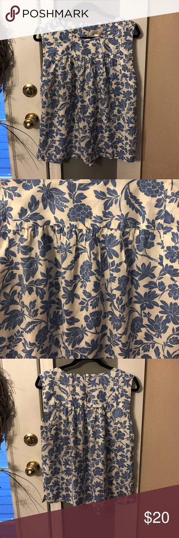 NWOT, Loft Blue & White Floral Top Never worn, excellent new condition. Pic of materials in photos. Measures approximately 21 inches in length and bust measures approximately 21 inches. Blue and white women's top. Tops Blouses