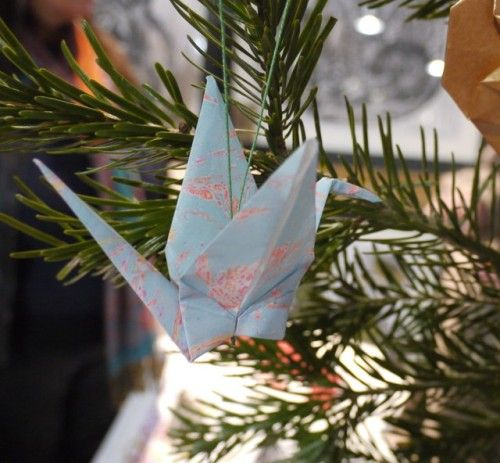 Marbled origami crane - can be used as a tree decoration then stored or hung around your home to add a pop of colour year round!  Luxury handmade paper decorations by Paper Street Dolls paperstreetdolls.etsy.com
