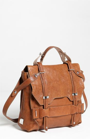 Soft, distressed leather with a lightly lustrous finish composes an updated top-handle satchel outfitted with an adjustable crossbody strap.
