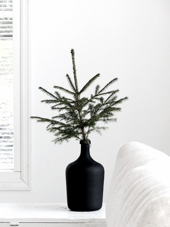 A lovely Christmas mini-tree in a black vase.: