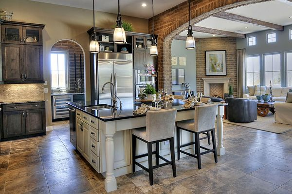brick; 2-color cabinets; island; open concept (don't like floor)