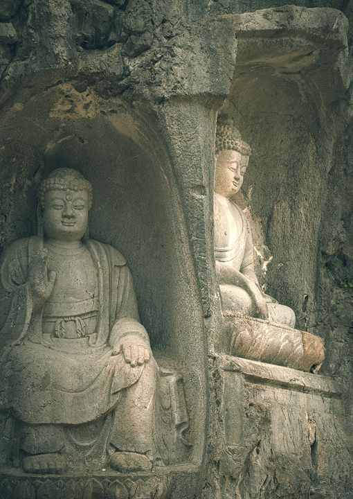 Two ancient Buddha statues in caves