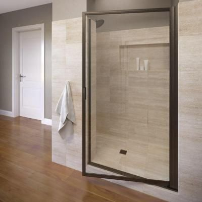 framed pivot shower door in oil rubbed bronze with clear glass