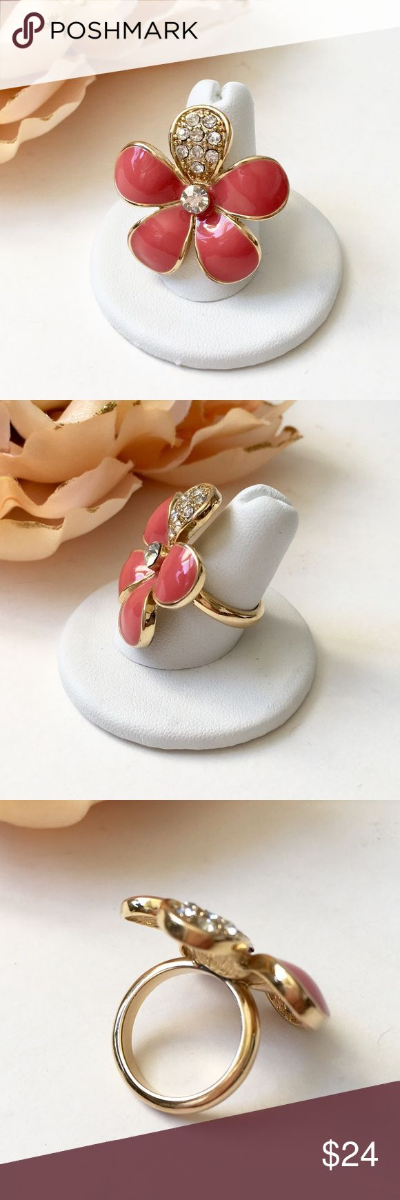 Enamel Flower Ring With One Petal of Crystals❤️ High quality costume piece. No makers mark. Weight: 0.5 oz. Color: milky deep coral. Polished gold-tone. Size: 6 1/2. Light wear...very good condition. Believe purchased at Macy's. Jewelry Rings