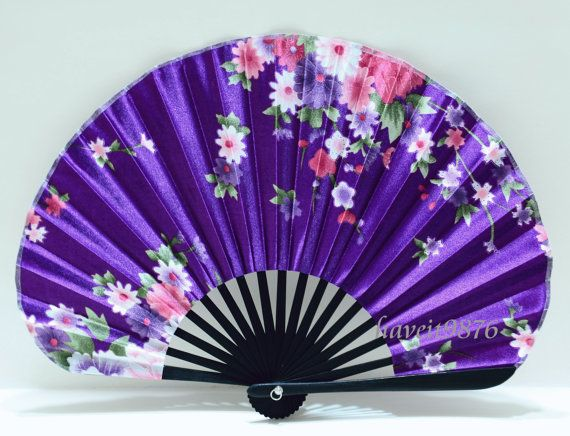 I like the rounded shape of the fan and the black stripes at the bottom as it stands out against the purple. I like how the flowers are all in shades of pink and also complements the purple background.