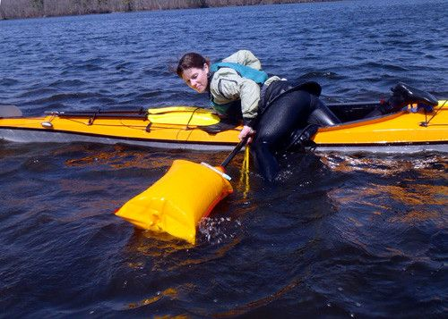 Amy Fullerton, eastern sales representative for Seattle Sports, shows how to use one her company's inflatable paddle floats and a rope sling to get back into her sea kayak. This is a skill you want to practice before you need it!