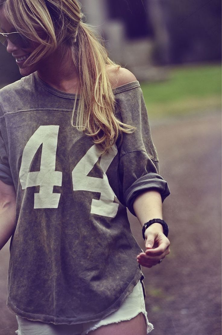 Oversized vintage jersey and white cutoff shorts.