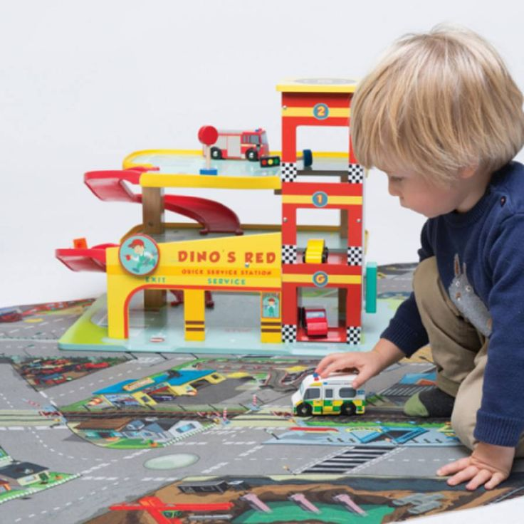 This great Personalised Wooden Toy Garage is 3 story with spiral ramps, petrol pump and a working lift and car. This also comes with a free petrol pump set which includes a van, a petrol pump, a set of traffic lights and two road works signs.
