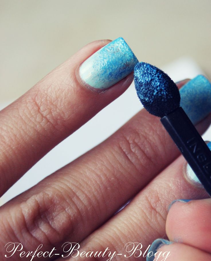 Ombre nails with an eyeshadow brush. Paint your nails with your base color, then apply the eye shadow and finish with a thick clear top coat to lock everything in!
