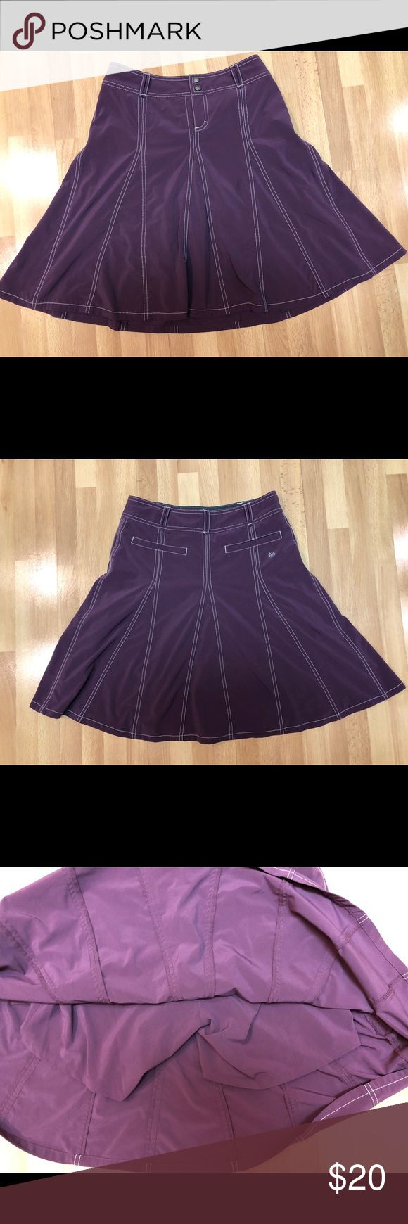 """Athleta Plum Whatever Skort - Tall EUC.  The moisture wicking and quick drying Featherweight Stretch polyester/spandex fabric is lightweight and slightly stretchy. The semi-fitted, A-line skirt has faux pleats and drapes nicely without being bulky. Built-in shorts are made from the same fabric, and allow you to be as adventurous as you want on your travels without worrying about showing off too much.  Length: 21"""". Athleta Skirts"""