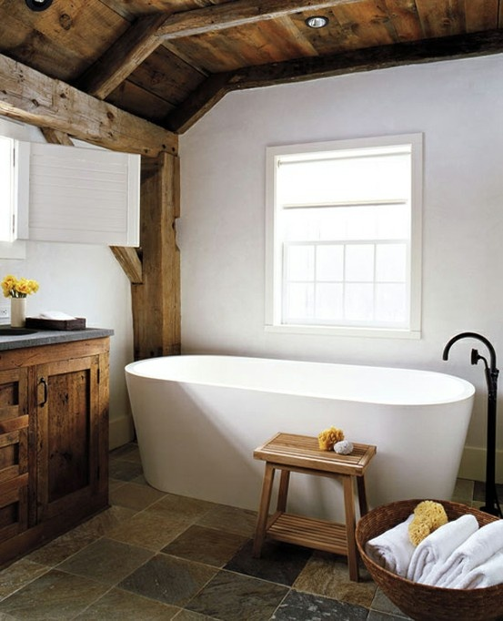 Wow.  I really love that tub!  And the large bowl basket with the towels.  And that awesome detached water faucet.  Did I mention the rustic wood beams and exposed ceiling decking?  The darker ceiling, beams, and floor really balance with the white simplicity.