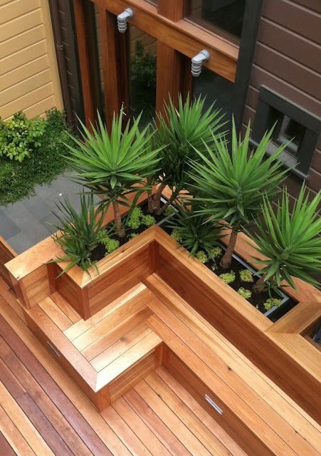 Beautiful wood bench and planter for low maintenance yard.