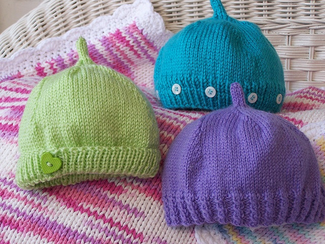 """Simple newborn hat. I've tried a few different patterns in the past, but they all end up having """"pointy"""" tops and don't fit correctly. These look round enough, I think... but will I have time to make one before the baby comes??"""
