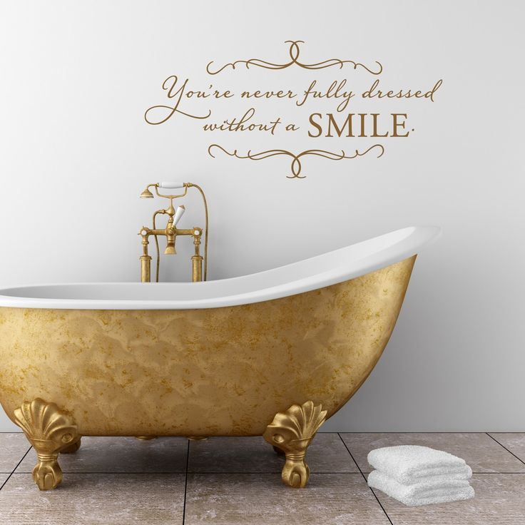 You're never fully dressed without a SMILE - vinyl wall decal. $34.00, via Etsy.