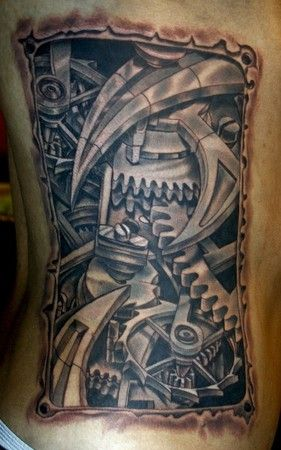 Bio mech gears tattoo by Todo of McDonough, GA