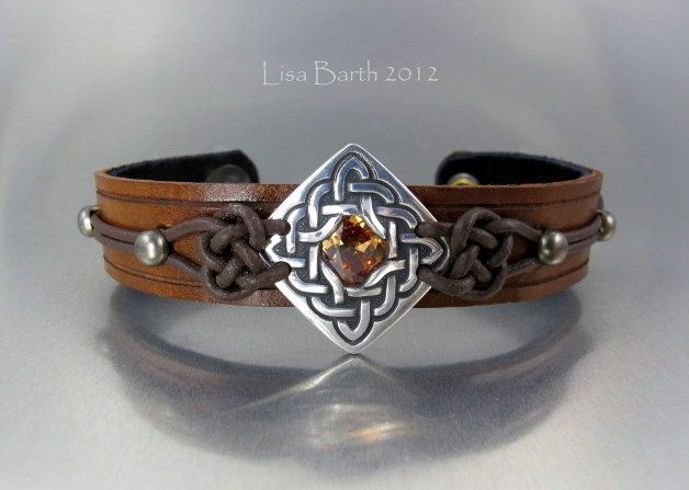 Here is a piece I made last year. Hand cut and dyed leather with a metal clay center piece.- Lisa Barth