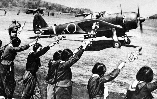 High school girls wave kamikaze pilot taking off, WW2, 12 april 1945