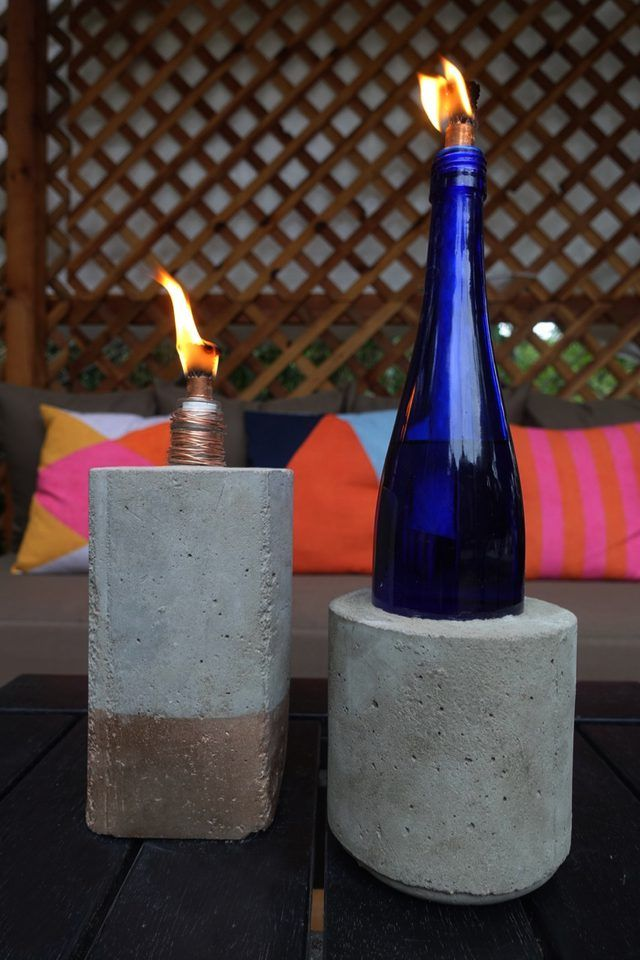 Cute! Tabletop concrete tiki torches out of used glass bottles.