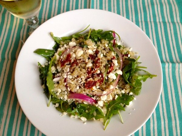 California pizza kitchen Quinoa and arugula salad - don't forget to add pine nuts (roasted) and grilled salmon on top.