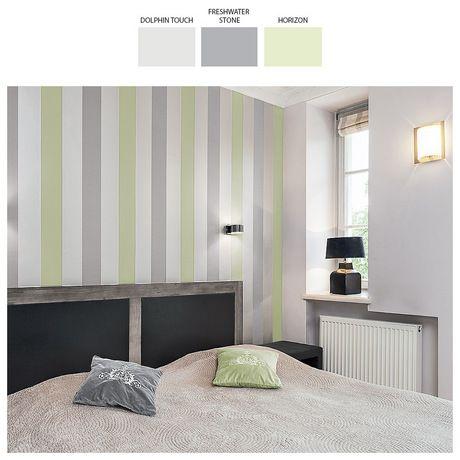 Pełna łagodności, stonowana aranżacja sypialni pomoże uspokoić myśli i wyciszyć emocje. Kompozycja barw jest tu bardzo harmonijna, lecz nie nudna – szarości przełamuje dodatek subtelnego seledynu, a charakteru dodaje całości prosta w wykonaniu, a przy tym efektowna dekoracja ściany.