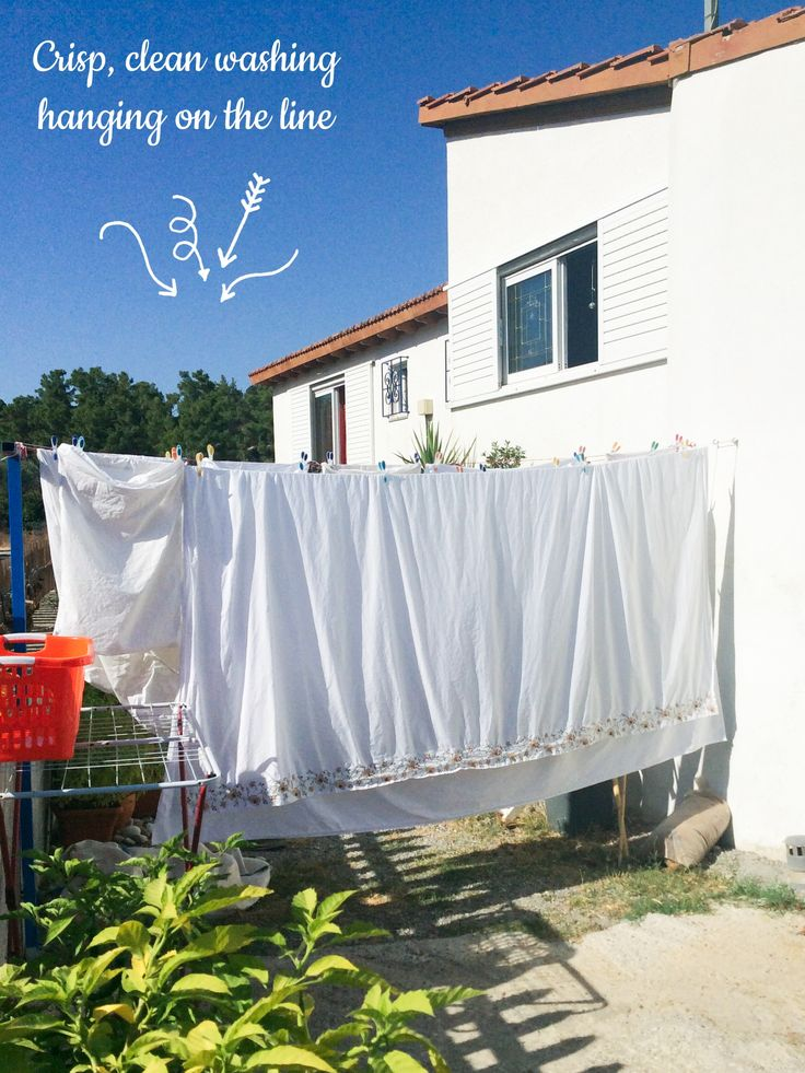 todays photo crisp clean washing hanging on the line, outside our little Greek house with a wonderful Greek blue sky