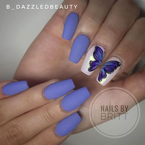 Spring butterfly wing nail art on blue matte coffin nails #springnails #springna…