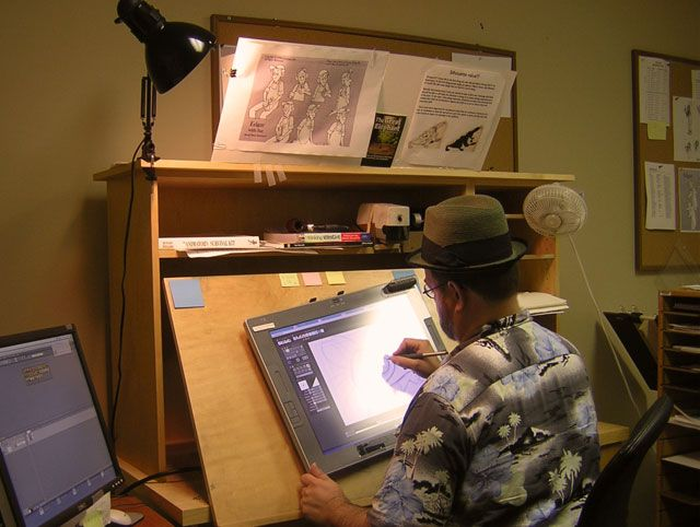 So there are these Cintiq drafting tables. But I am thinking of something that will let me have a monitor inset in the desk surface, and then a plexiglass cover for traditional drafting that will also double as a light table with the monitor on.