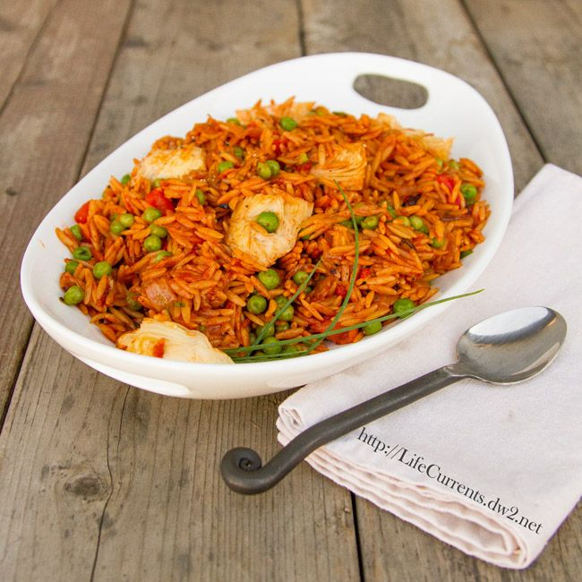 Quick and Easy Paella Recipe Main Dishes with olive oil, yellow onion, orzo, low sodium vegetable broth, smoked paprika, saffron threads, kosher salt, ground black pepper, dry white wine, frozen peas, red pepper, canned artichoke quarters, fresh parsley