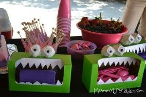 Neat way to contain napkins, cutlery etc. at a kid's birthday party.  Could probably recycle Kleenx boxes for this and decorate them in ways other than dragons/monsters.