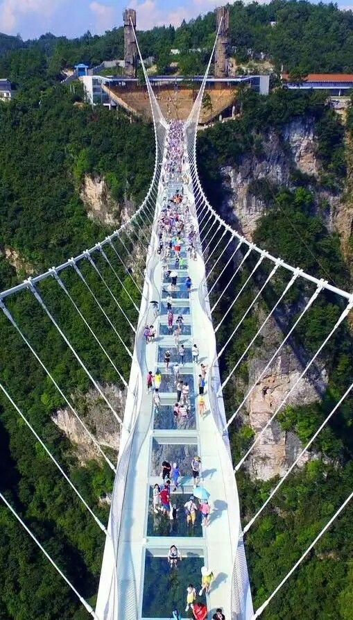 Zhangjiajie Grand Canyon Glass Bridge a 430-metre-long glass bridge has been constructed across a deep canyon in China's Zhangjiajie National Forest Park (+ slideshow). Designed by architect Haim Dotan, the Zhangjiajie Grand Canyon Glass Bridge is believed to be the world's longest and tallest glass pedestrian bridge Glass panels are set into its walkway, giving visitors vertigo-inducing views and photo opportunities of the canyon below http://www.suntzulives.com/