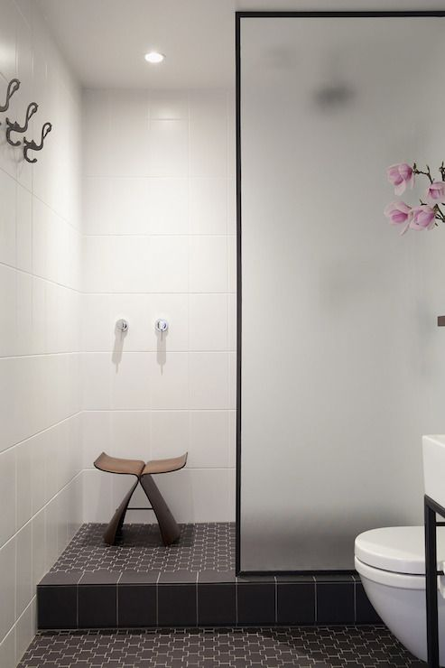 Very zen -- big white tile on shower wall, and same tile in shower floor as bathroom floor (not this color)