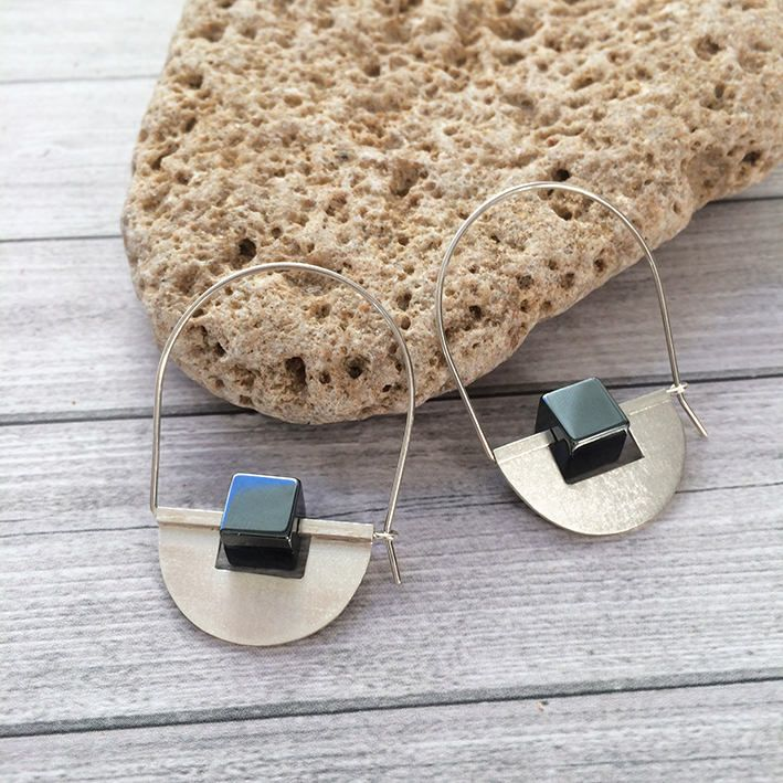 One of the best-selling EARRINGS is back at the Store. You better hurry, because there's only one pair available. Sterling Silver hoop earrings - half moon -tribal earrings -hematite cube stones -geometric earrings http://etsy.m