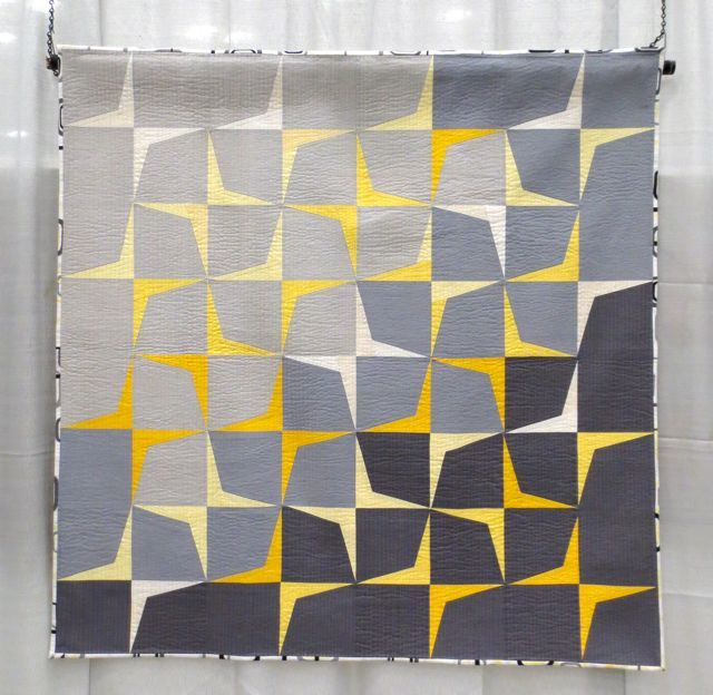 Trajectory #2, made and machine quilted by Megan Dye, inspiration: mid-century-modern boomerang motif, 1st Place, QuiltCon 2013(category: Use of Negative Space, Large)