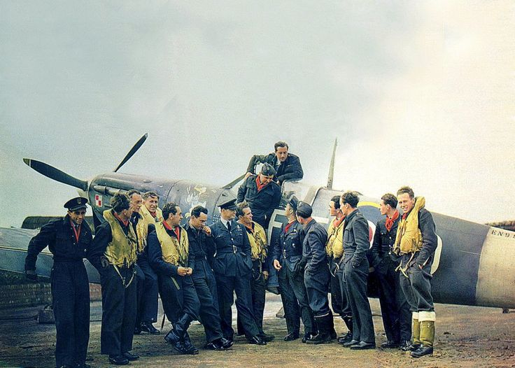 Pilots of RAF Polish Squadron 303 pose with their Squadron Leader, Jan Zumbach, in front of his Spitfire at Kirton-in-Lindsey, Lincolnshire, England (October 1942)