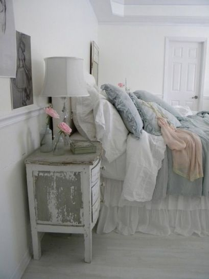 the bedding looks divine, and the chippy night stand is pleasing.